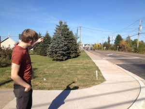 Ryan Taylor points to where the first shots were fired on Hildegard Drive following the Moncton shooting.