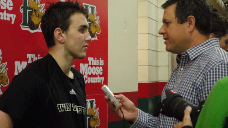 Halifax Mooseheads forward Kelly Bent talking with Willy Palov post-game.