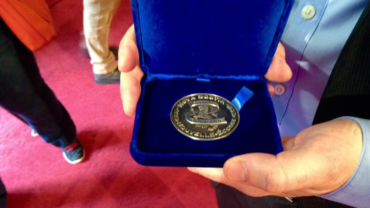 Dr. Nathan Urquhart displays his Medal of Bravery