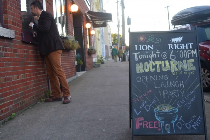 An onlooker curious about Nocturne's opening night celebration at Lion & Bright on Agricola Street. (Photo: Emma Jones)