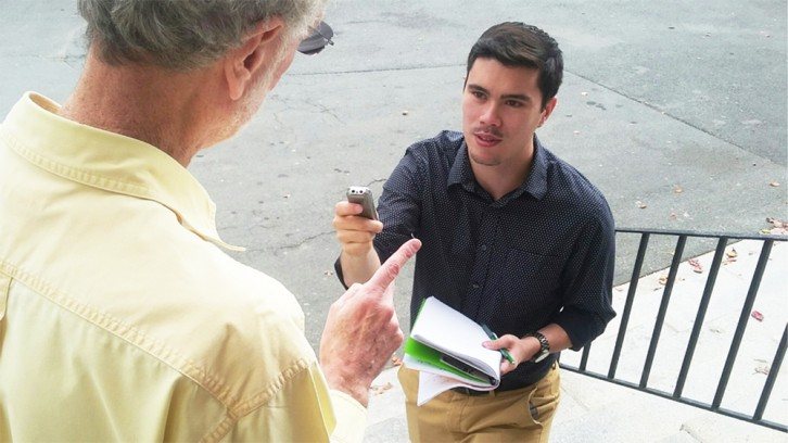 A young journalist doing an interview at the University of King's College.