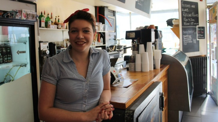 Walker at the cafe inside Halifax Backpackers, called Alteregos. Guests often relax in the cafe/ common area, she says.