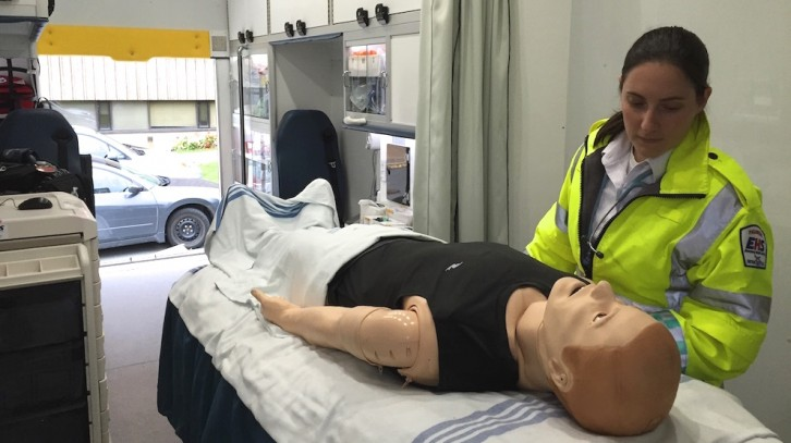 Janel Swain, clinical supervisor of the Mobile Simulation Unit, with a simulator.