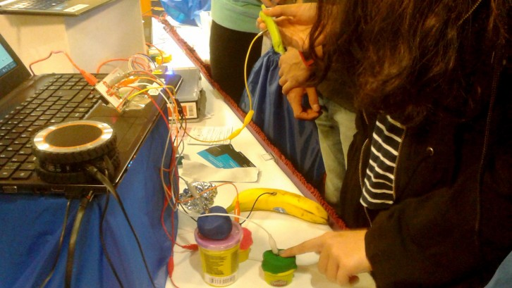 Students use Play-Doh and other objects as touchpads with the Makey Makey.