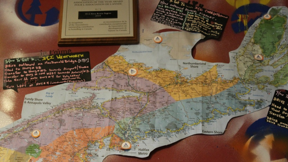 The walls of HI Halifax are plastered with travel information.
