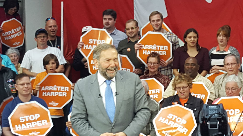 NDP leader Tom Mulcair surrounded by supporters at a rally in Dartmouth