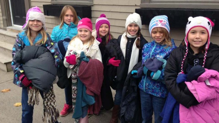 A group of young Caledonia girls handed out warm clothes in Halifax over the weekend.