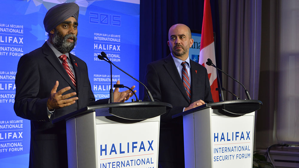 (Left to Right) Minister of National Defence Harjit Sajjan and Peter Van Praagh speaking at a press conference during the forum