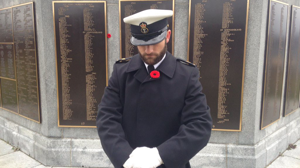 A soldiers looks down in remembrance for the fallen at the Point Pleasant Park ceremony.