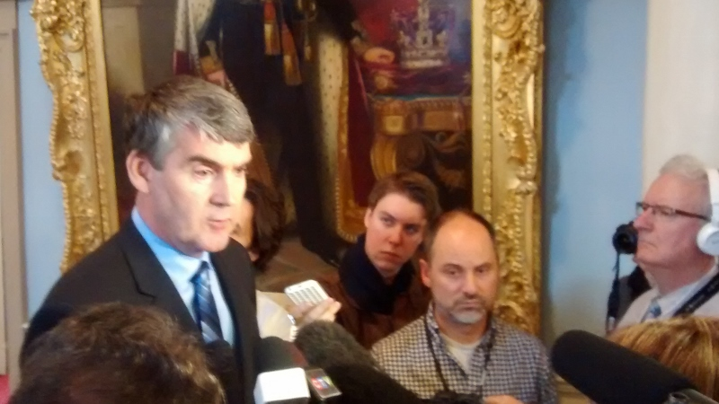 Premier Stephen McNeil answers questions before the opening of the fall session of the House of Assembly