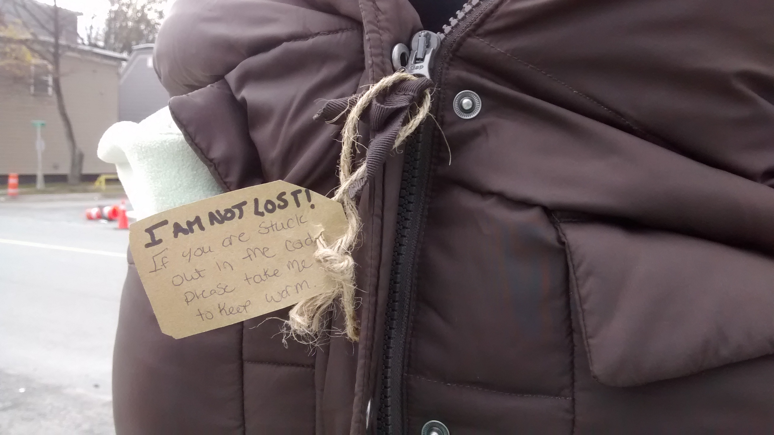 Caledonia students left arm jackets on telephone poles on Halifax streets. Tags on the coats let people know the items were free to take.