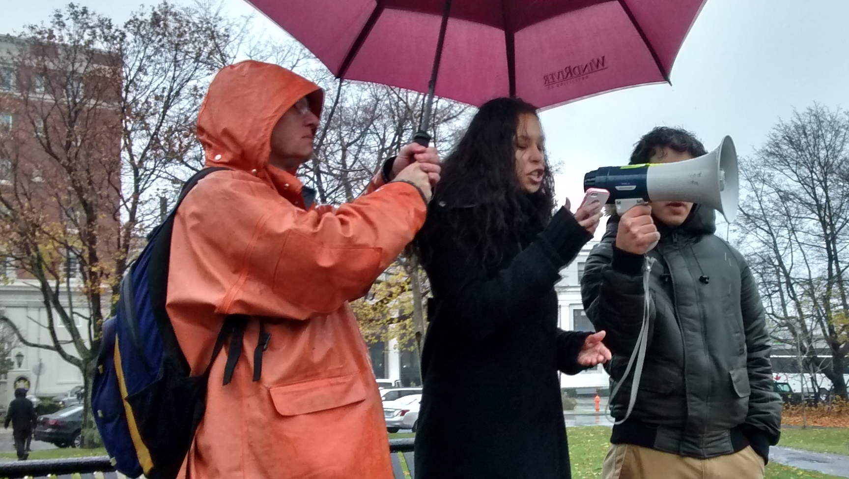 El Jones recited a poem during the rally outside The Westin Hotel