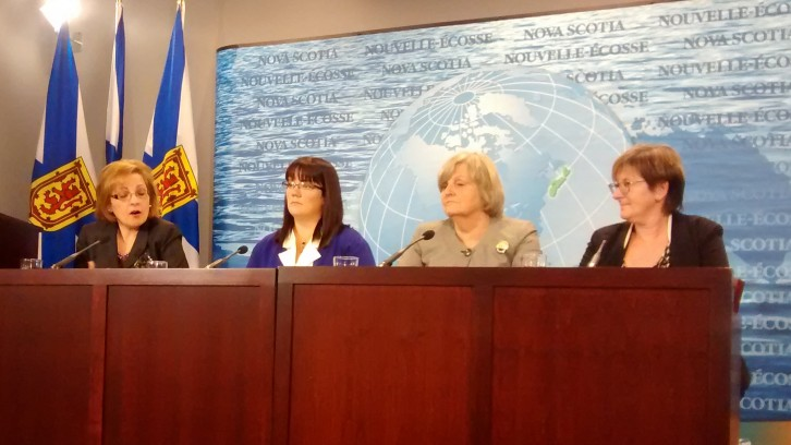 Lena Metlege Diab, Suzanne Ley, Gerry Mills and Barbara Miller Nix speak at a news conference.