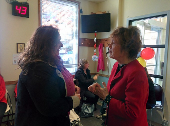 Margaret Casey (right) welcomes a patient to the North End Community Health Centre