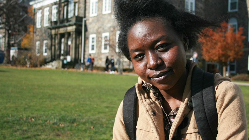 Wenasa Alaraba on the quad at Dalhousie. She grew up in Kukuma Refugee Camp, Kenya before coming to Halifax in 2014.