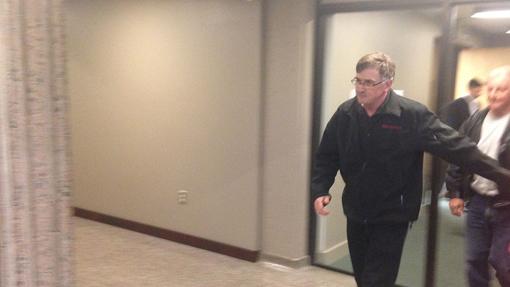 Paul Calnen leaves the courtroom after the jury is sequestered for the night.