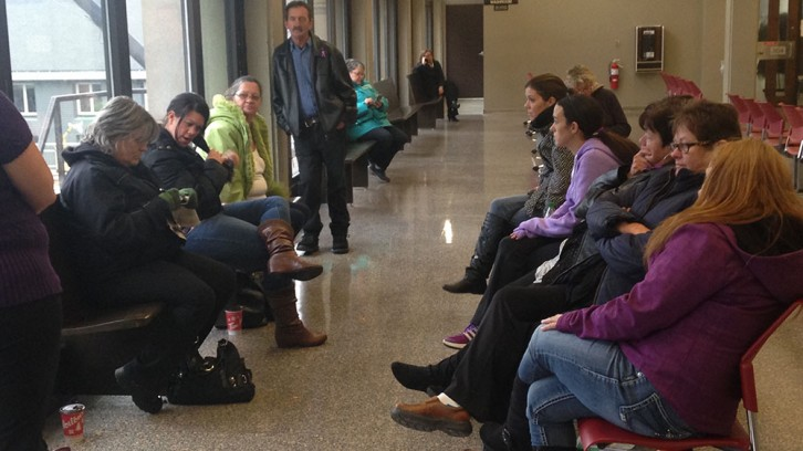 The Jordan family waits patiently outside the courtroom for deliberations to end. They come to the courthouse everyday hoping justice will be served.