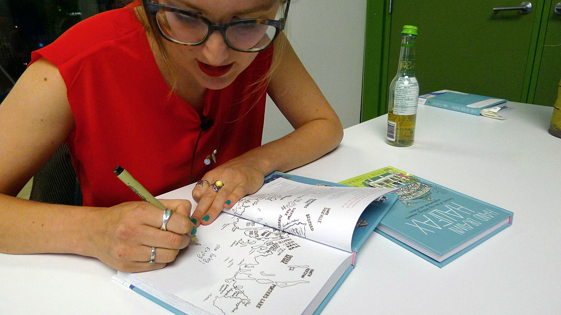 Fitzgerald signing copies of Hand Drawn Halifax at her book launch at the Halifax Central Library.
