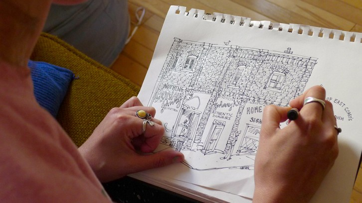 Emma Fitzgerald sketching in her apartment in North End, Halifax.