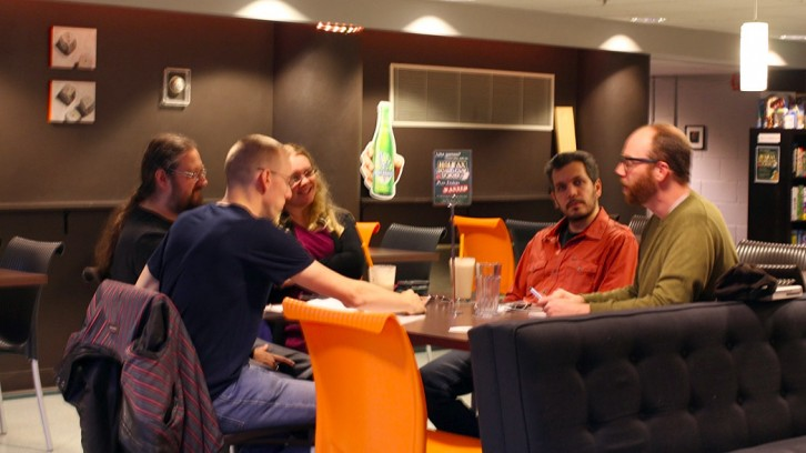 Fraser, far right, talking shop at the Board Game Designer's Night.