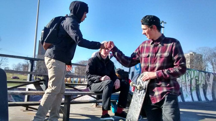 Sam Greenberg greets a friend as Tristan Connellan looks on. They skate at the Halifax Commons every day.