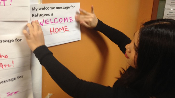 Open house attendees leave a message for future refugee arrivals.