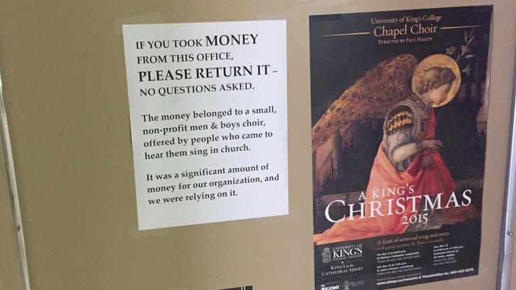 This sign was placed by Vanessa Halley, asking for the money to be returned.