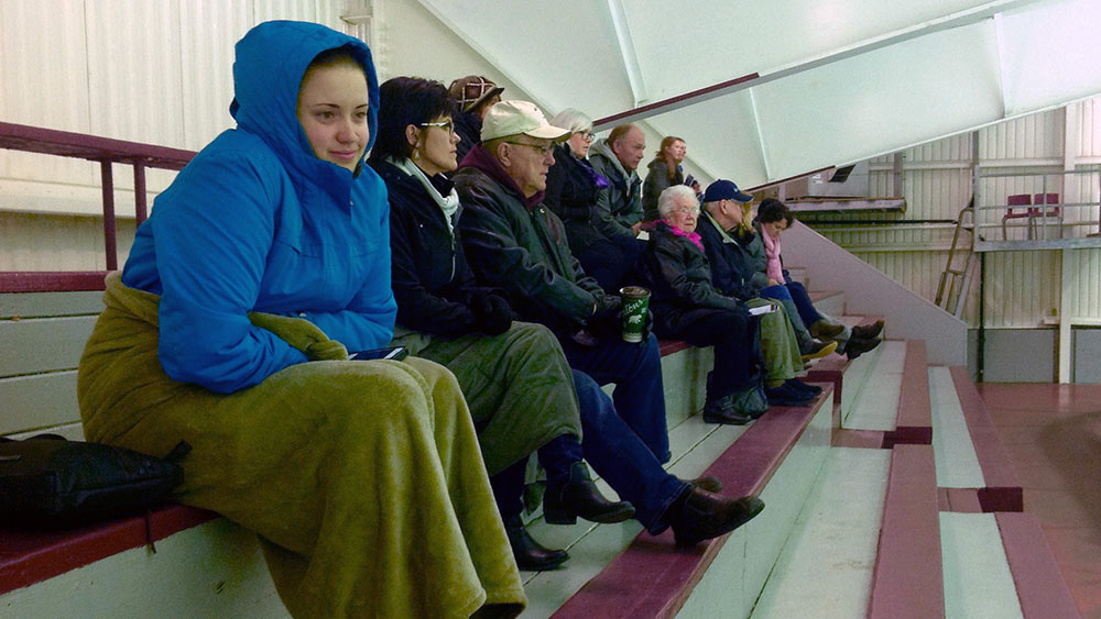 Fans at Saturday's hockey game at Alumni Arena bundle up to keep warm in the rink.