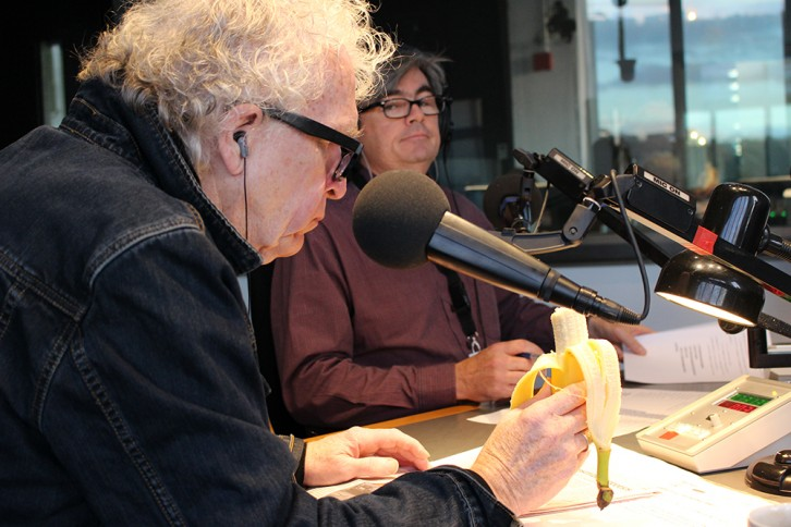Sandy Smith looks on as Don Connolly enjoys his usual breakfast in the studio.
