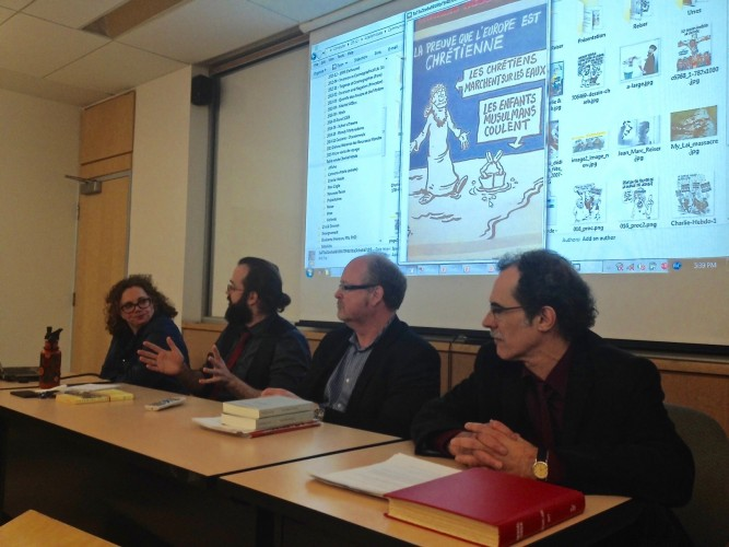 From left to right: Amal Ghazal, associate professor of history; Vincent Masse, assistant professor of French; Christopher Elson, associate professor of French and canadian studies; Vittorio Frigerio, chair of the French department at Dalhousie University. Background photo: recently published cartoon by Charlie Hebdo.