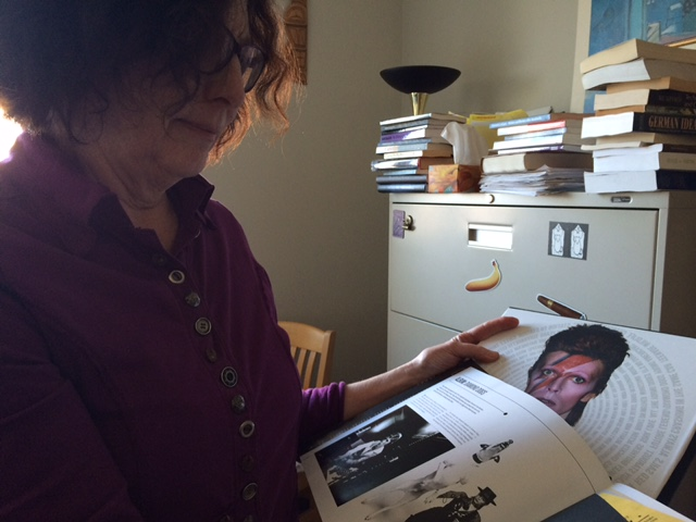 Professor Elizabeth Edwards looks fondly at a picture of David Bowie.