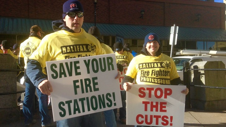 Dozens of shirts and signs were handed out by HRM career firefighters.