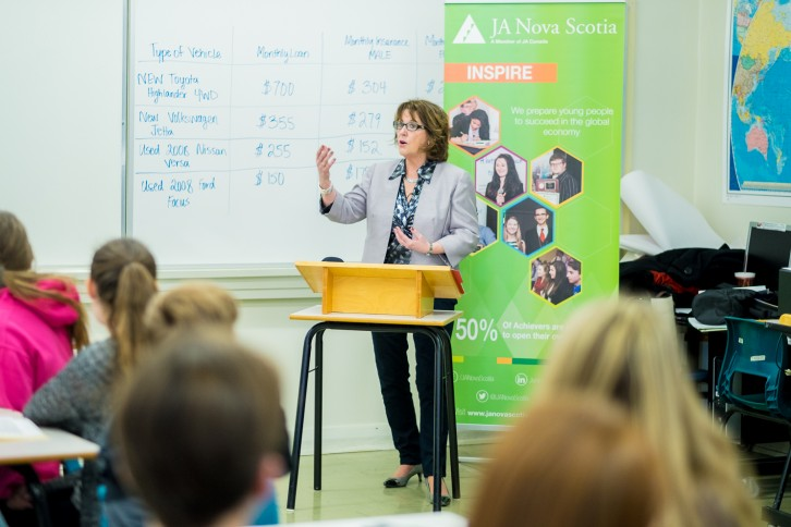 Minister of Education and Early Childhood Development Karen Casey announces the partnership between the province and Junior Achievement to a class of ninth graders at Ellenvale Jr. High in Dartmouth.
