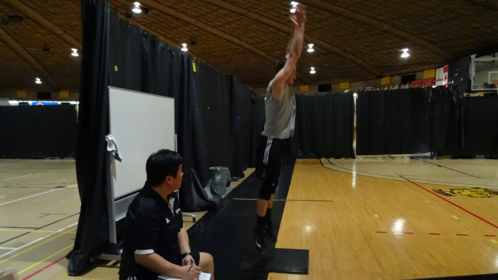 Coach Ota watches on as a player tests his jump height