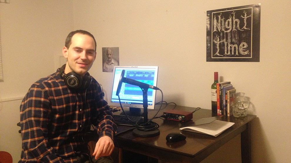 Jordan Bonaparte sits at his desk, preparing to record the next episode of Night Time Podcast.