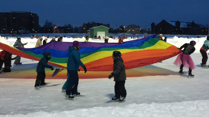"With Lady Gaga's hit song ""Born This Way,"" playing through the loudspeakers, skaters paraded around the Oval with a huge rainbow banner."