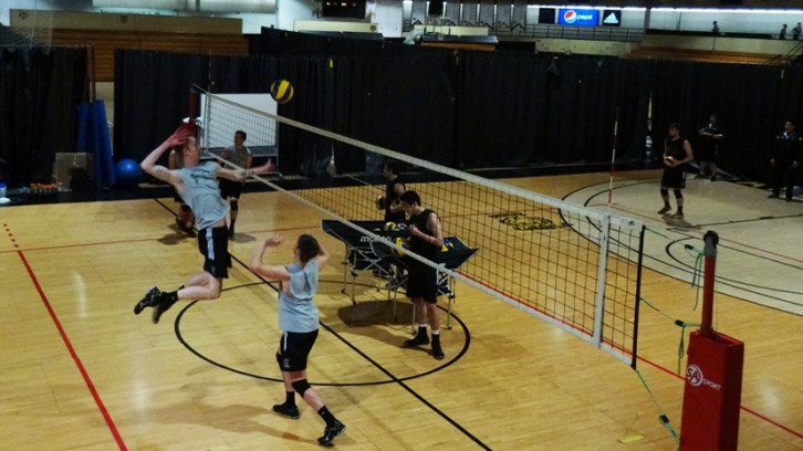 A player jumps to spike the ball