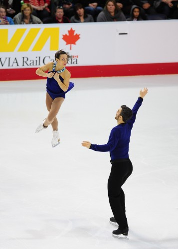 Meagan Duhamel being thrown into a spin by Eric Radford
