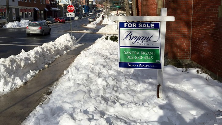 "A ""for sale"" sign blows in the wind along Queen ST. in Halifax, N.S."