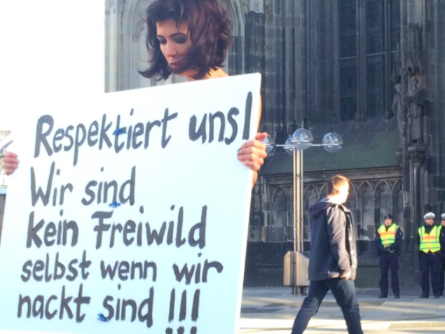 A German protester demands respect after the attacks on women on New Years Eve