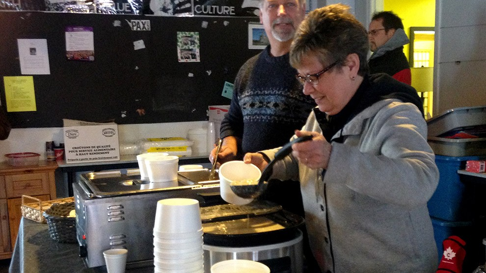 Volunteers serve soup to guests at Souls Harbour Rescue Mission.