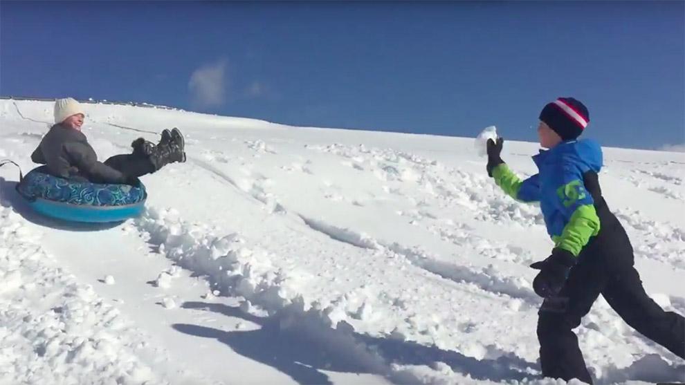Elementary students sliding  on Citadel Hill