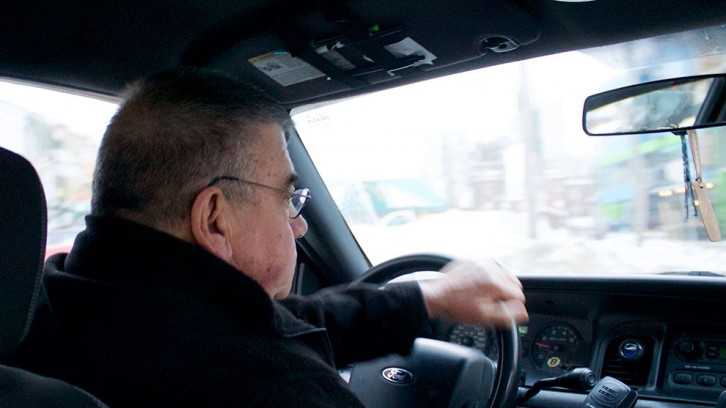 Charles O'Connell navigates rush hour traffic and snow banks in downtown Halifax.