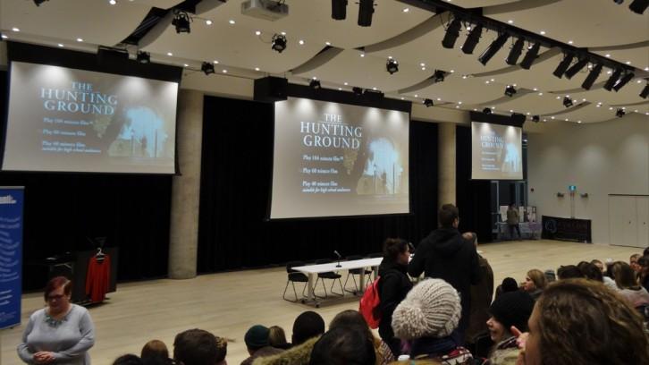 Audience members prepare to watch
