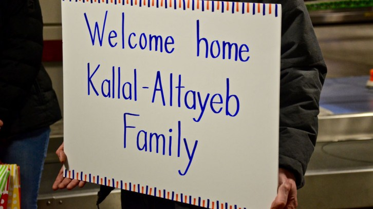 Signs were made to welcome the family to Haifax.