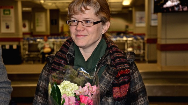 Kathleen Cawsey waits with flowers.