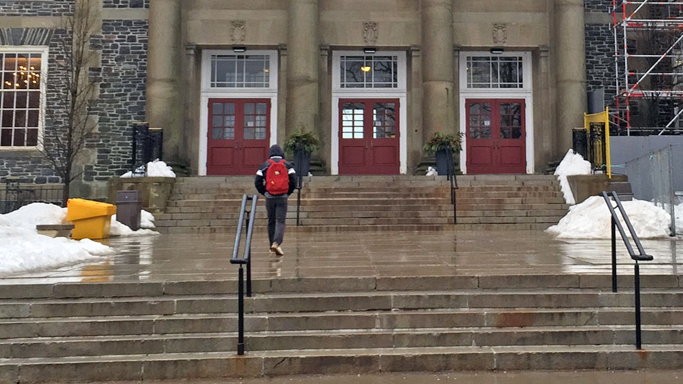 A student walks to Dalhousie in the rain