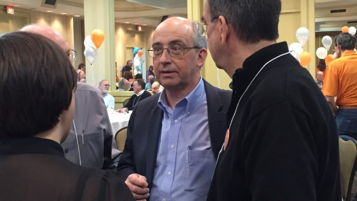 Gary Burrill, centre, strategizes minutes before it announced he will become the provincial party leader.