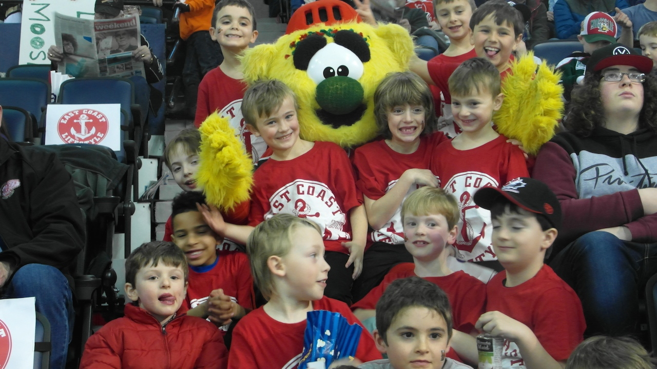 Hal with some young fans at a Mooseheads game