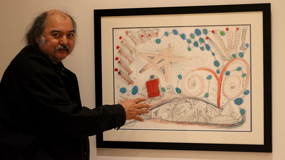 Alan Syliboy explains the meaning of his acrylic and ink painting at The Path We Share exhibit at the Art Gallery of Nova Scotia.